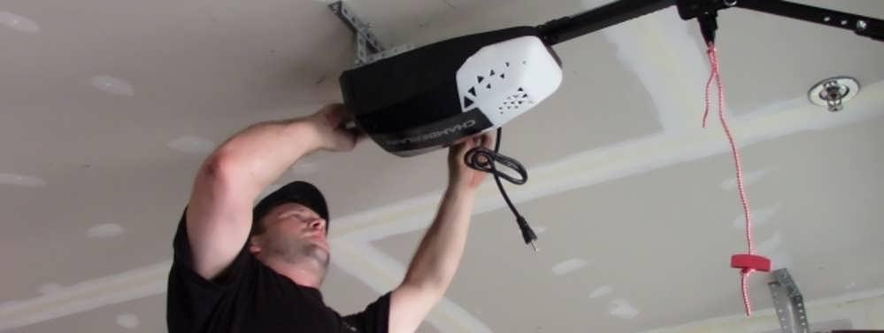 """alt=""""Technician Shane installing A Chamberlain .05 HP Opener"""""""
