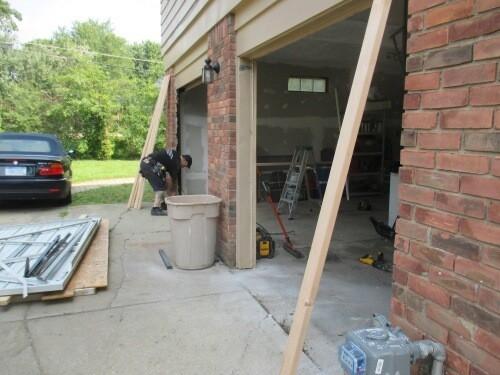 """alt=""""five star doors installer Shane installing a door track on a new door"""""""