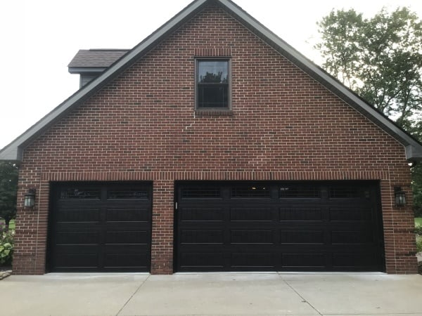 """alt=""""amarr lincoln 3000 double and single door in black with windows on a red brick colonial home"""""""