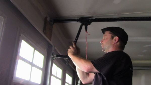 """alt=""""five star door technician Shane installing a Chamberlain opener 2 piece rail"""""""