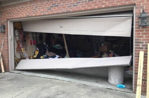 """alt="""" a garage door in need of garage door cable replacement"""""""